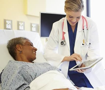doctor and bed-bound patient talking